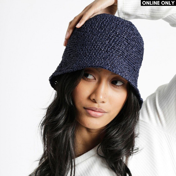 Joanne Hat Pattern in Wool and the Gang® Ra-Ra Raffia
